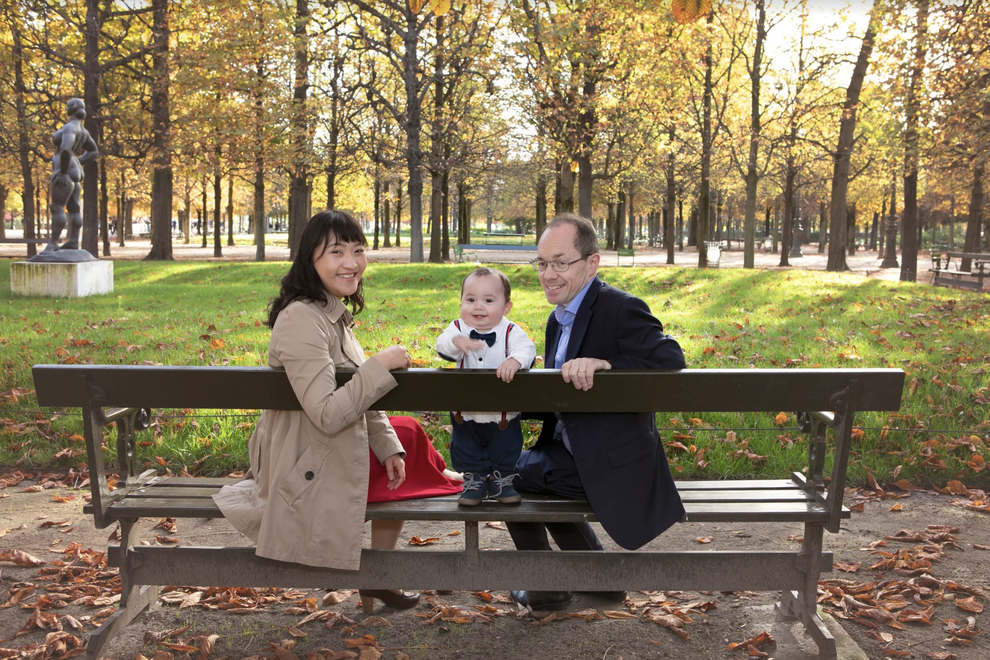 family on a bench in Tuileries garden