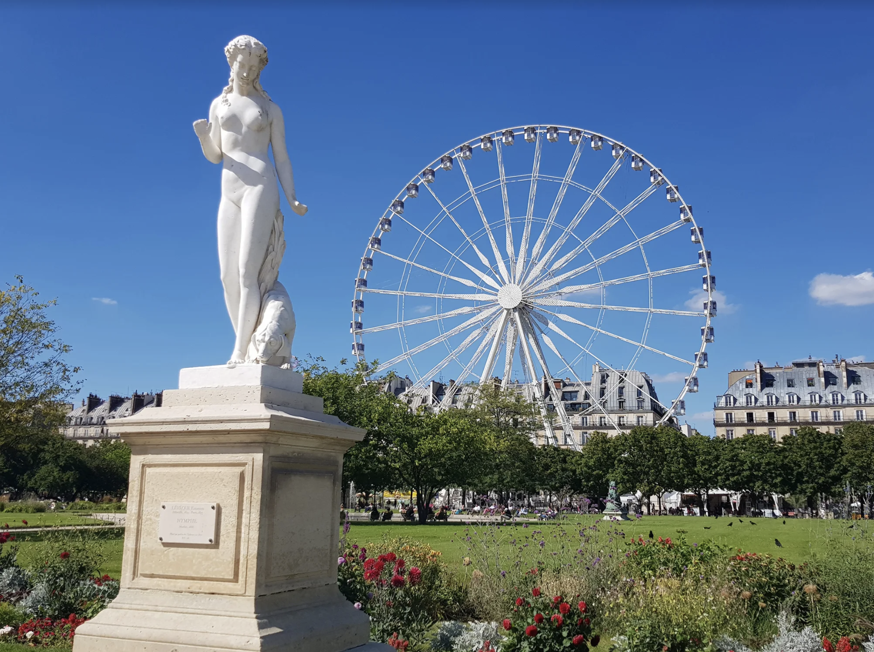 Statue in Tuileries garden with a big wheel in the background