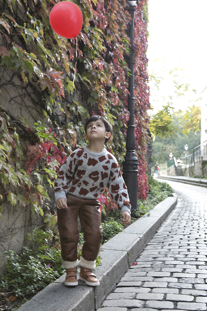little boy spotting a ballon in the air