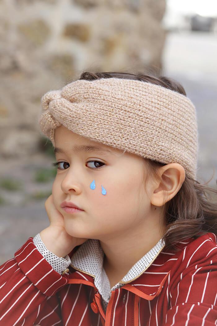 pensive little girl with 2 teardrops