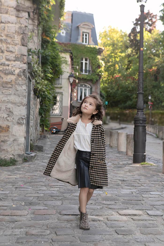 little girl strolling in Montmartre
